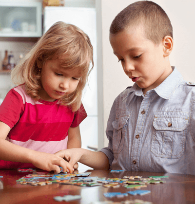 Children with puzzle